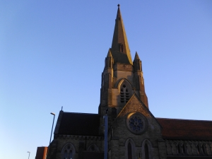 A large stone spire against a blue sky.