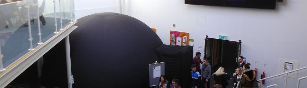 A large black igloo-like structure